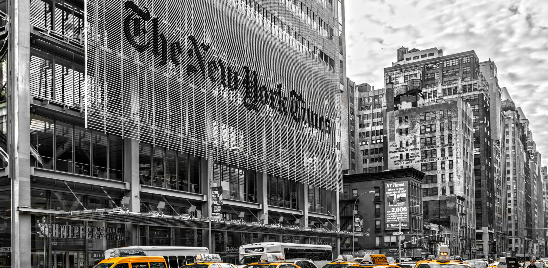 NEW YORK CITY - DEC 01 The New York Times building and characteristic Yellow Taxi Cab,on December 01th, 2013 in Manhattan, New York City. USA.