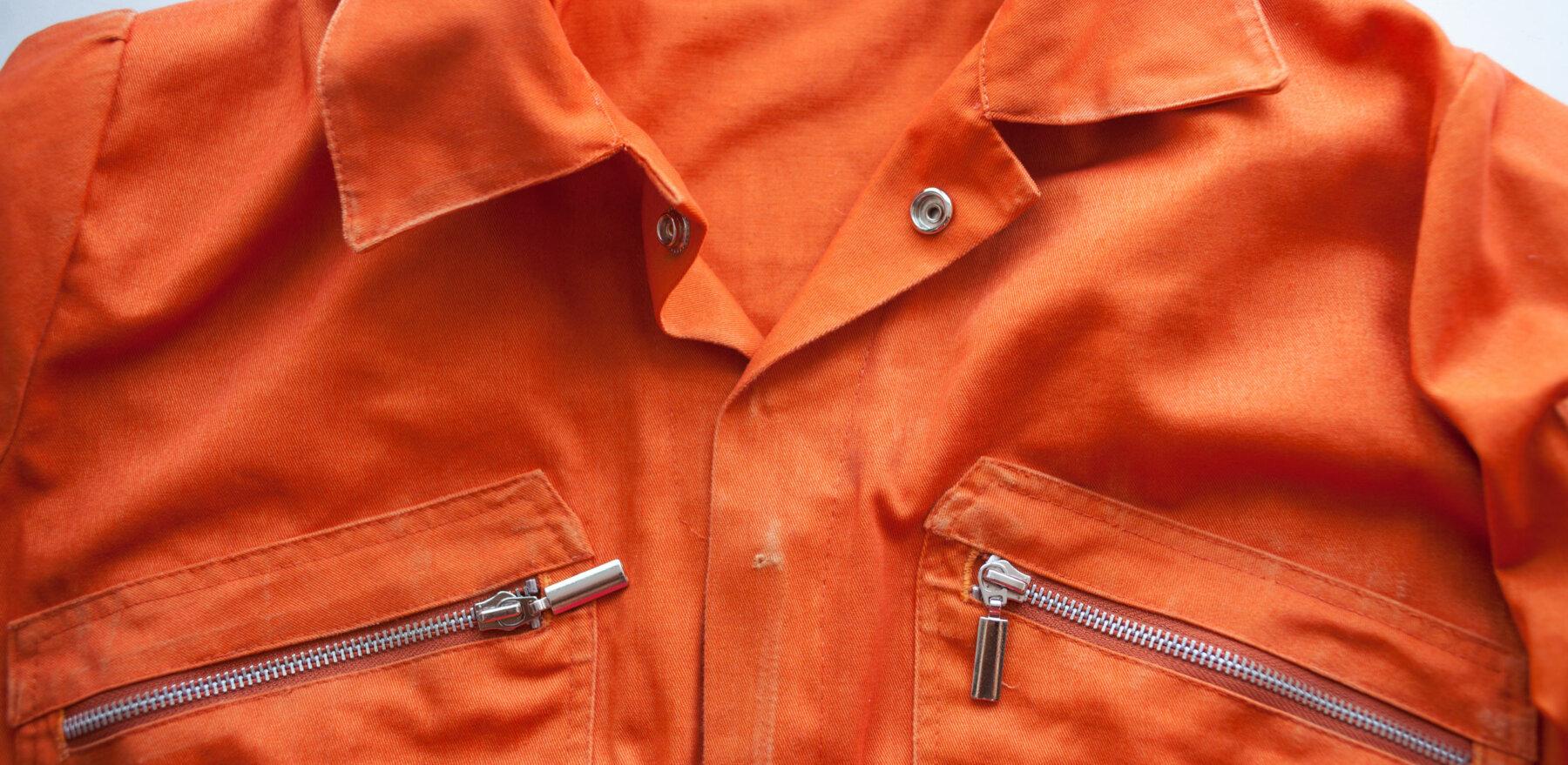 An orange jumpsuit of a prisoner. close up. Prison clothes, prisoner overalls